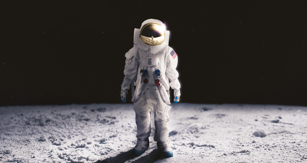Astronaut standing on the moon in space suit.