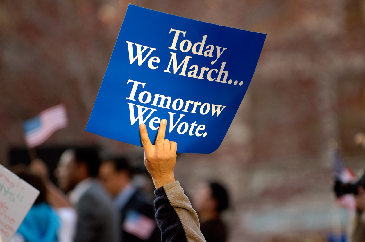 Placard for teen activists that says today we march; tomorrow we vote.