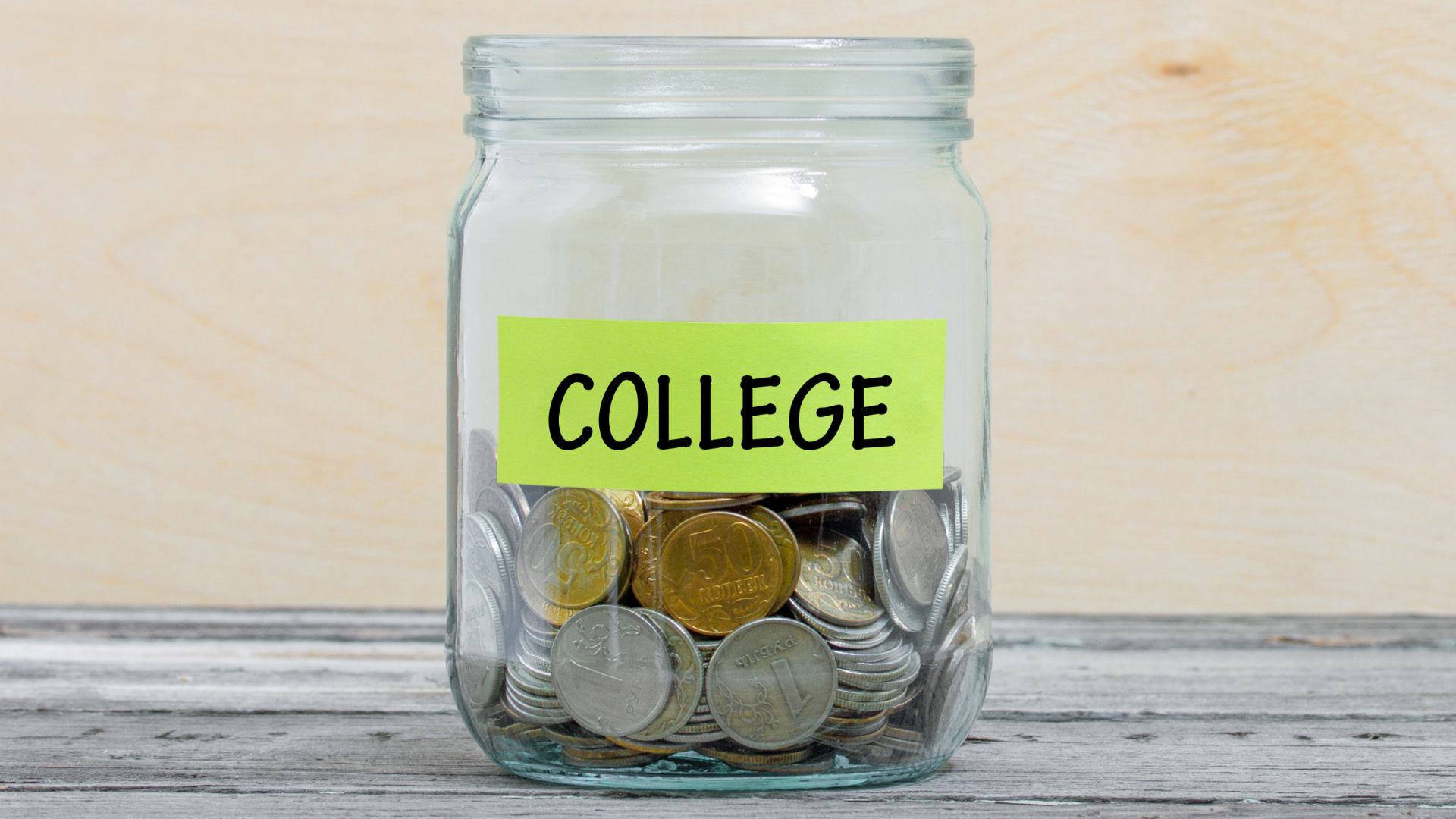 """A jar full of coins is labeled """"college"""""""